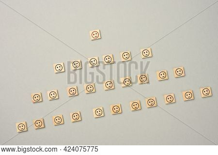 Wooden Blocks With Figures On A Gray  Background, Hierarchical Organizational Structure Of Managemen