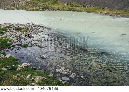 View From Top To Turquoise Mountain Lake With Transparent Water. Atmospheric Mountain Landscape With