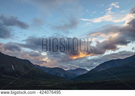 Beautiful Mountain Scenery With Golden Dawn Light In Cloudy Sky. Scenic Mountain Landscape With Illu