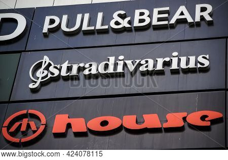 Bucharest, Romania - June 08, 2021: The Logo Of The Several Famous Brand Are Seen On The Facade Of M
