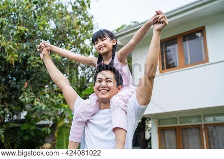 Asian Happy Family Father With Cute Daughter Outdoor Having Fun Playing The Pilot Of An Airplane At