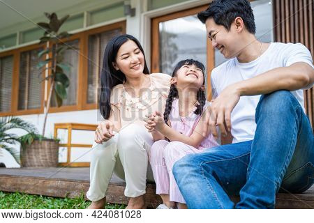 Asain Happy Family Spend Leisure Time Together, Parents Look To Young Little Smile Girl Daughter Wit