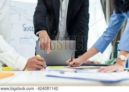 Close Up Hands Of Business People Group Meeting In Office. Man And Woman Brainstorm And Work As Team