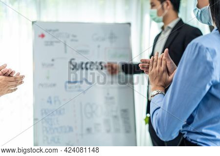 Asian Businessman Leader Report Work On Whiteboard To Colleagues Team While Brainstorm In Meeting Ro
