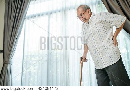 Asian Senior Elderly Disabled Man Patient Walking Slowly With Walker Or Cane At Nursing Home Care. O