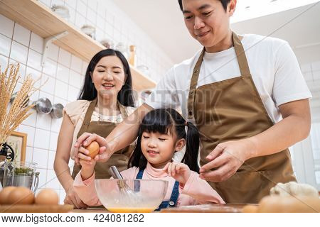 Asian Happy Family Stay Home In Kitchen Spend Time Together Baking Bakery And Foods. Little Preschoo
