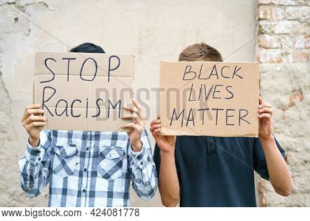 Poster That Says Black Life Matters And Stop Racism In The Hands Of A Young Man. Caucasian Guy Stage