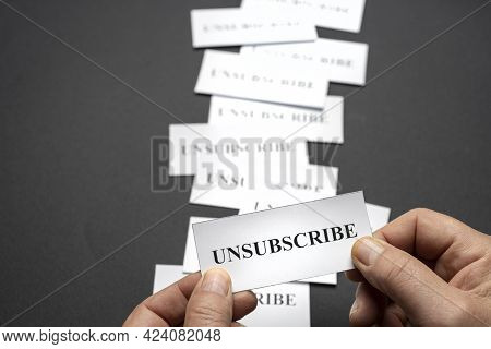 Some Tickets With The Word Unsubscribe Arranged On The Table, As A Concept Of The Choice To Cancel S