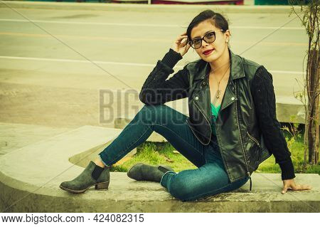 Latin Girl With Sitting On A Bench, Attractive Girl With Glasses Sitting On A Bench