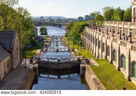 Rideau Canal Locks In Ottawa, Canada. View On Ottawa River, Alexandra Bridge And Gatineau City Of Qu