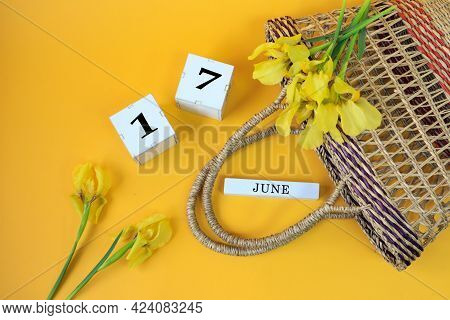 Calendar For June 17: Cubes With The Number 17, The Name Of The Month Of June In English, Yellow Iri