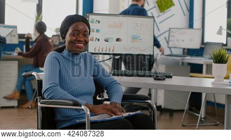 Happy African Businesswoman With Disabilities Looking At Camera Smiling In Immobilized Paralysed In