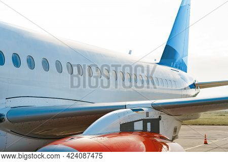 Close Up Of Passenger Airplane On The Airport Runway