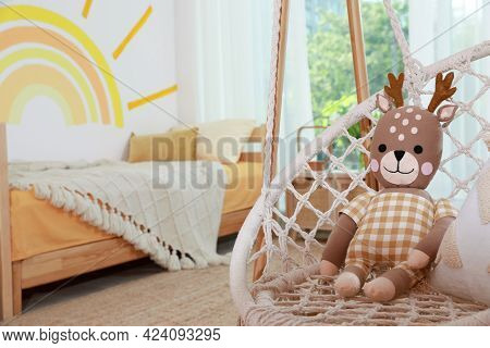 Swing Chair With Toy Reindeer In Child's Bedroom, Space For Text