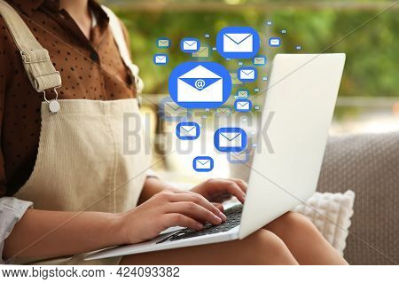 Woman Sending Emails Near Window At Home, Closeup