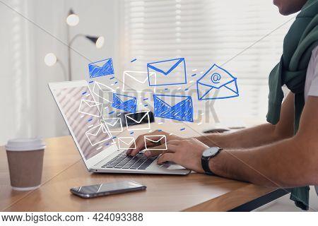 Man Sending Emails At Table Indoors, Closeup