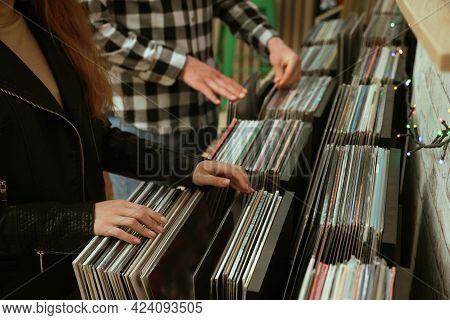 People Choosing Vinyl Records In Store, Closeup