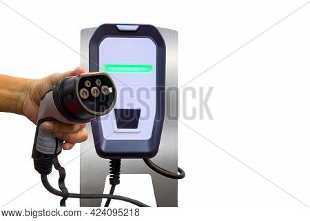 Left Hands Of Men Who Are Holding Industrial Plug Connect Of Electric Charge Machine For Fueling Bat