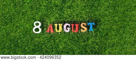 August 8. Image Of Wooden Colored Letters And Numbers On August 8 Against The Background Of A Green