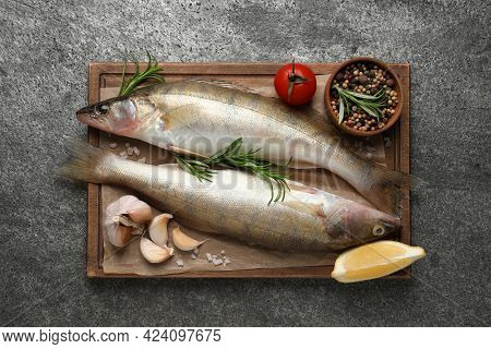 Fresh Raw Pike Perches And Ingredients On Grey Table, Top View. River Fish