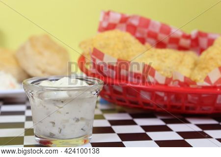Fried Catfish With Tartar Sauce And French Fries
