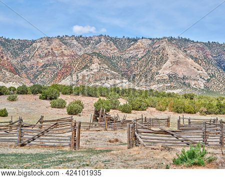 cattle corral in arid landscape of north western Colorado with prominent Cliff Ridge near Dinosaur National Monument
