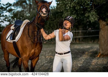 Very Happy Horse Poses Next To Its Owner. They Are Happy Together .concept Of A Proper Lifestyle.con