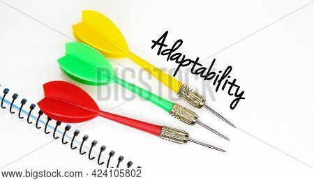 Arrows, White Paper With The Word Adaptability