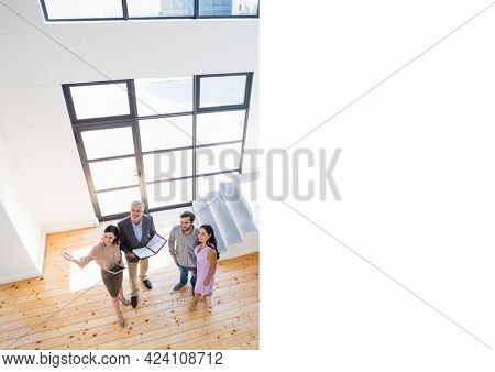 Composition of real estate agents showing couple sunny modern property. property, ownership and investment concept digitally generated image.