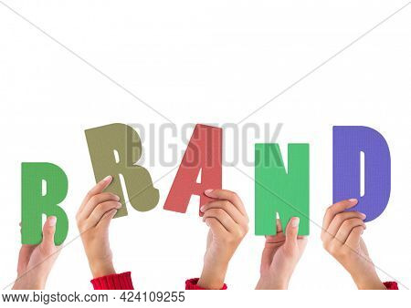 Composition of hands holding colourful letters, spelling out the word brand, on white. global business, communication and marketing concept digitally generated image.