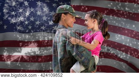 Composition of female soldier with her daughter over american flag andr fireworks. american patriotism and independence concept digitally generated image.