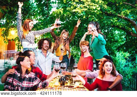 Friends Having Fun Outdoor Toasting Red Wine At Garden Party - Happy People Eating And Drinking Toge