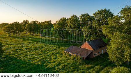 A Picture Of A Old Barn And Pasture During Fall With Colors. High Quality Photo
