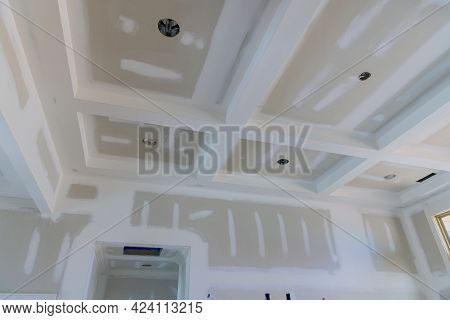 Plastering Gypsum Drywall Seams On The Walls And Ceiling Of A Newly House On Process Of Applying Lay