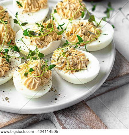 Deviled eggs on a white plate