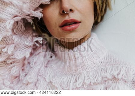 Portrait of a cheerful woman in a light pink sweater