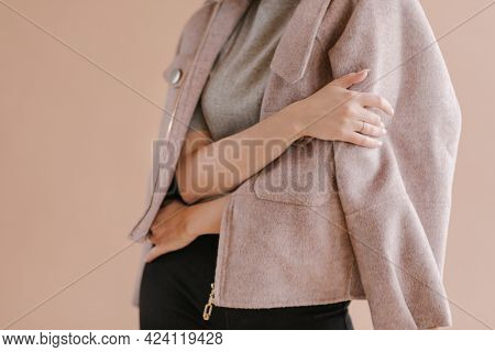 Crossed arm in a studio shoot