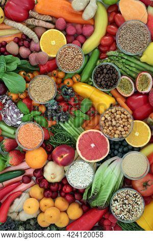 Antioxidant health food to fight free radicals with fruit, vegetables, legumes, grains, cereals, herbs and spices. High in fibre, anthocyanins, protein, vitamins, minerals and carotenoids. Flat lay.