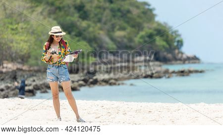 Happy Traveler And Tourism Women Travel Summer On The Beach. Asian Smiling People Holding Map And C