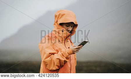 Woman using her mobile phone in the highlands