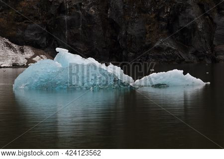 The Wonderful Blue Color Of A Small Iceberg In Tracy Arm