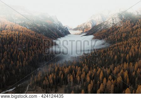 The Dolomites shrouded by the mist during autumn