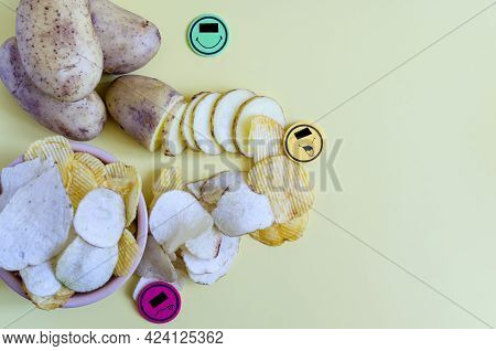 The Concept Of Turning Potatoes Into Chips In A Negative Way. Potatoes, A Slice Of Potato And Fluted