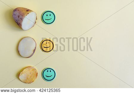 The Concept Of Turning Potatoes Into Chips. Potatoes, A Slice Of Potato And Fluted Chips Close-up On