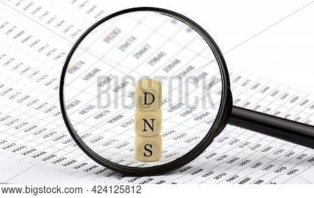 Dns Wooden Cubes On The Chart Background , Look Through A Magnifier