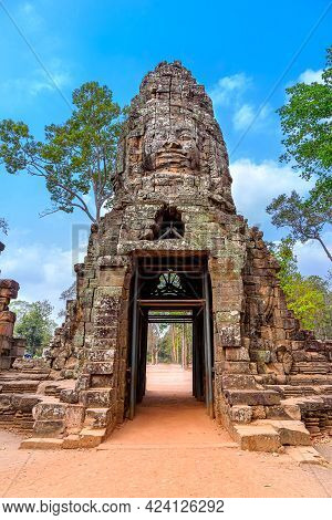 Face Carved Stone Arched Entrance To Ta Prohm Temple In Angkor Thom, Siem Reap, Cambodia.