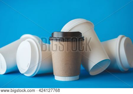 Recycle Brown Paper Coffee Cup Mockup, Take Away Cup For Drinks Isolated On Blue Background With Spi