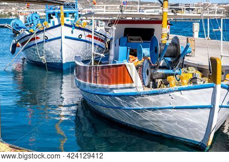 Fishing Boat Anchored At Milos Island Harbor. Greece