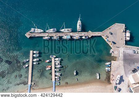 Ios Island, Marina Port Aerial Drone View. Greece, Cyclades.