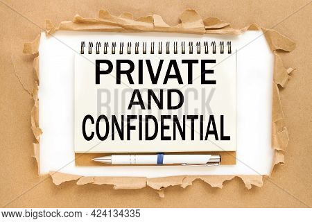 Private And Confidential. Text On Notepad Near Torn Paper